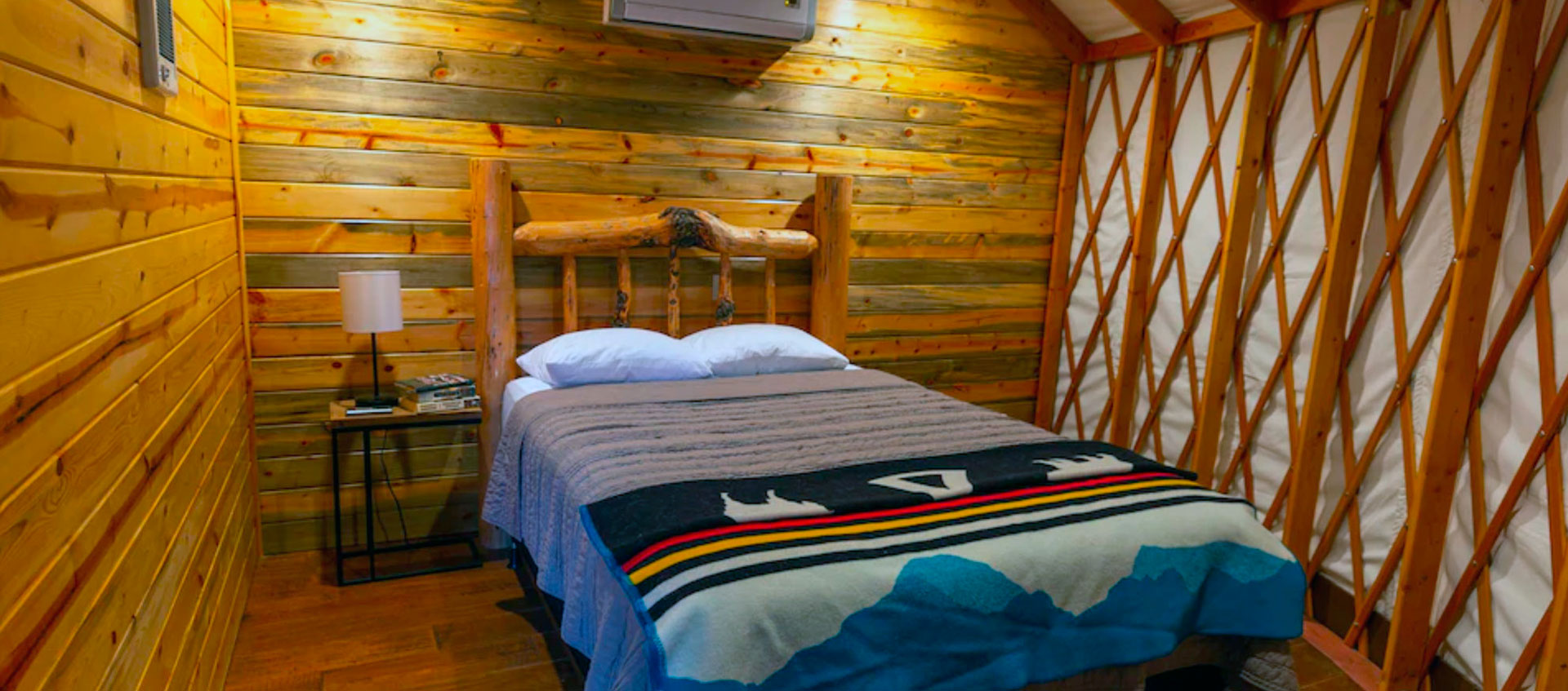 A Bedroom in The Yurt at Craig | Fly Fishing Vacation Rental in Craig, MT